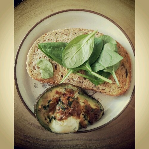 Avocado Egg with whole grain bread and baby spinach